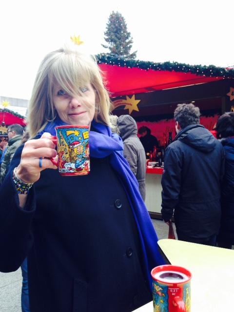 Susan holding mulled wine mug